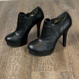 Jennifer Lopez black leather platform booties